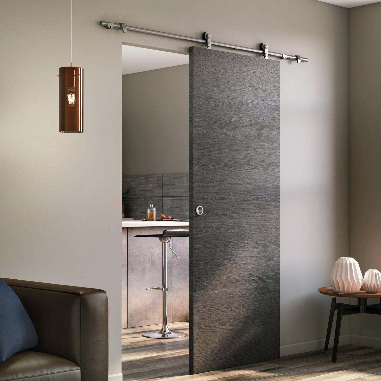 une porte coulissante en bois sur rail inox pour s parer. Black Bedroom Furniture Sets. Home Design Ideas