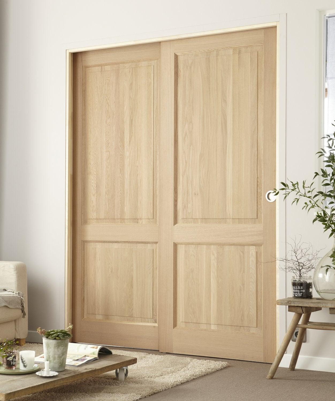 une double porte coulissante au style classique leroy merlin. Black Bedroom Furniture Sets. Home Design Ideas