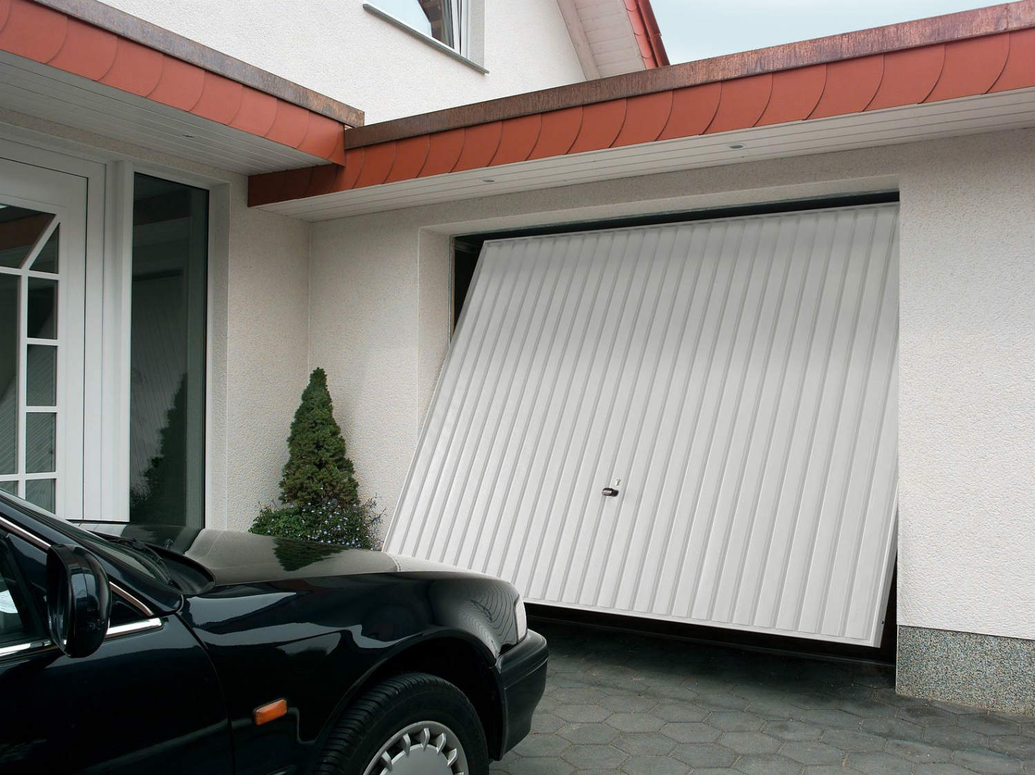 Comment motoriser une porte de garage basculante leroy for Piece porte garage