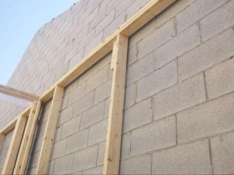 Comment construire un mur en parpaings coller leroy for What does porte mean