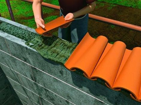 Comment construire un mur en parpaings coller leroy for Pose tuile canal sur muret