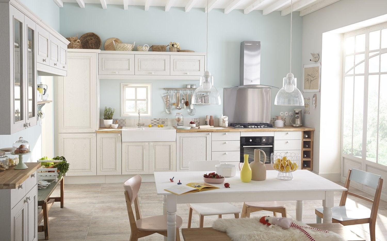 Une cuisine vert pastel et blanche qui allie design et for Tous les cuisinistes
