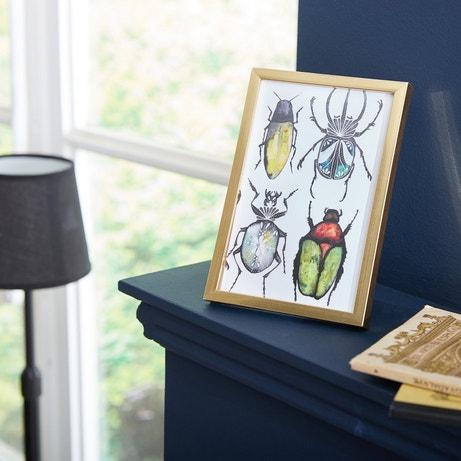 Donnez un peu de gaieté à votre intérieur, avec un cadre photo doré