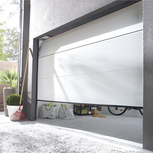 Pose d 39 une porte de garage sectionnelle artens essentiel for Porte de garage prix pose