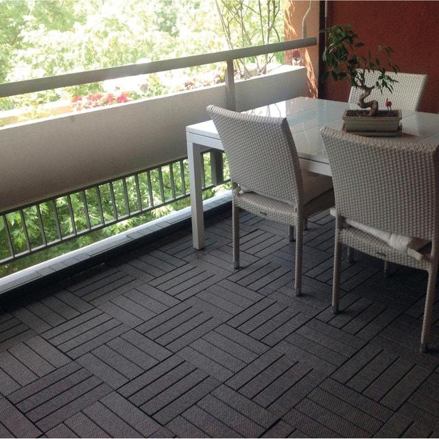 un petit tapis qui habille la terrasse leroy merlin. Black Bedroom Furniture Sets. Home Design Ideas