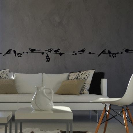 Pochoir oiseaux sur un fil dans le salon