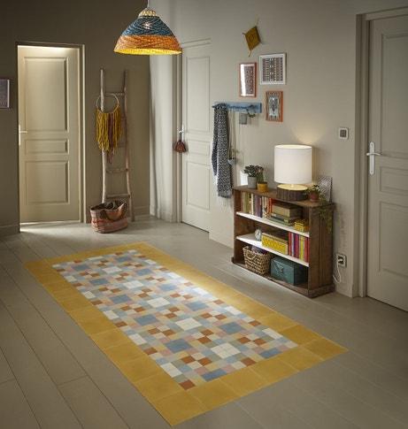 Un tapis en trompe l'oeil avec des carreaux de ciment