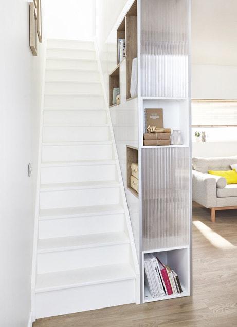 Une cloison de séparation dissimulée en meuble de rangement